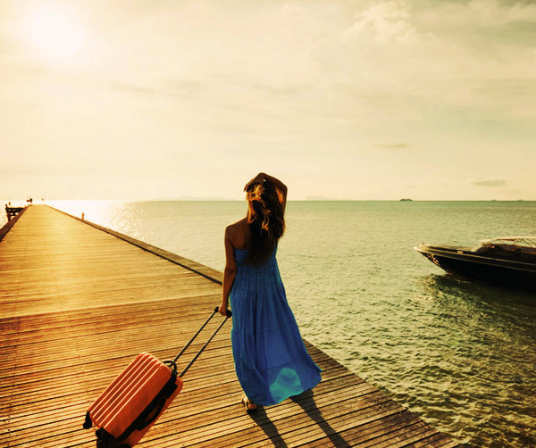 young-woman-with-suitcase-on-the-pier